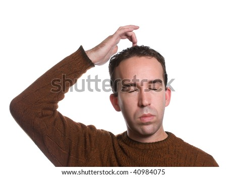 """A man wearing a sweater is doing the """"emotional freedom technique"""" by tapping on the top of his head, isolated against a white background - stock photo"""