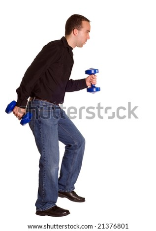 A man wearing casual clothing taking a brisk walk with a set of dumbbells - stock photo