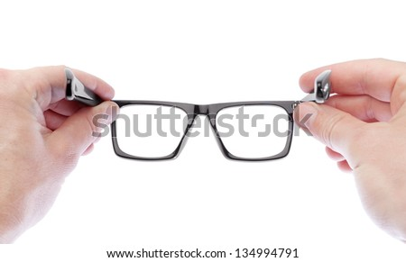 A man wearing glasses to improve vision. On a white background. - stock photo