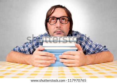 A man who embraces books and loves to learn - stock photo