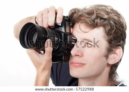 A man with a camera on a white background