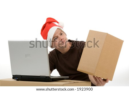 a man with a christmas hat, a laptop and a blank package