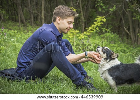 A man with a dog on the nature