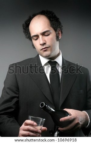 a man with a glass and bottle of wine - stock photo