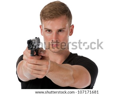 A man with a handgun aiming it towards the viewer.