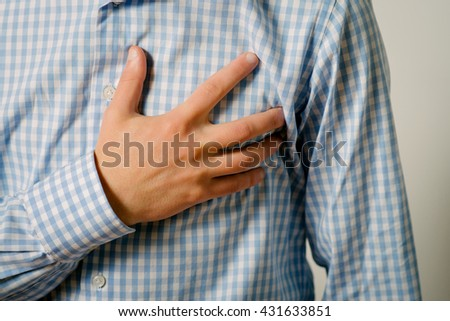 A man with a heart attack - stock photo