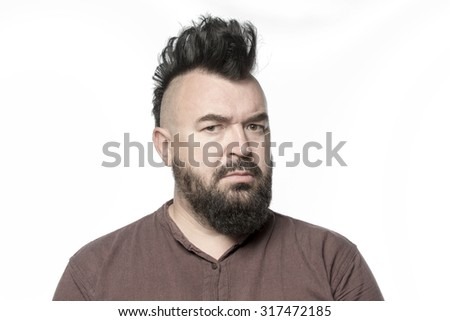 A man with a mohawk and beard, isolated
