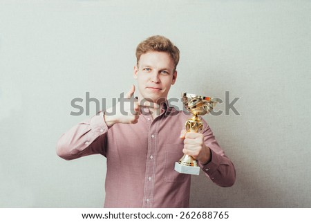 a man with a prize trophy - stock photo