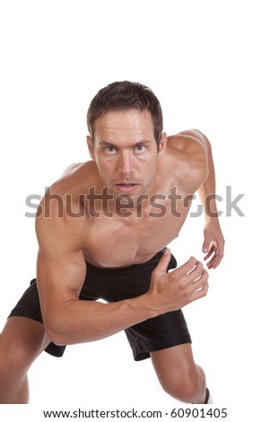 A man with a serious expression running - stock photo