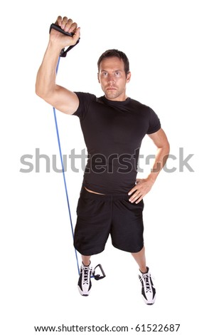 A man with a serious expression using his exercise bands to workout his arms. - stock photo