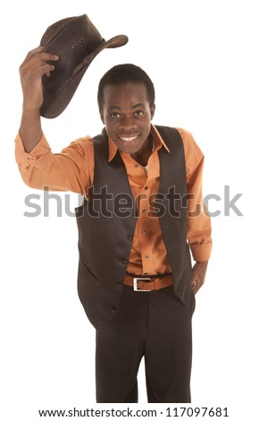 A man with a smile on his face taking off his cowboy hat - stock photo