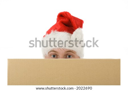 a man with an christmas hat looks over an empty cardboard