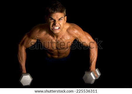 a man with an intense expression on his face, doing a push up on weights. - stock photo