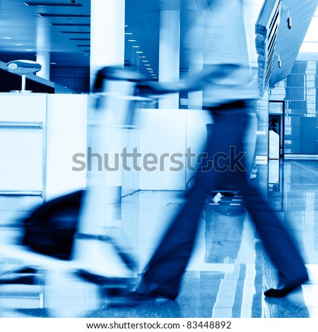 A man with baggage in an airport - stock photo