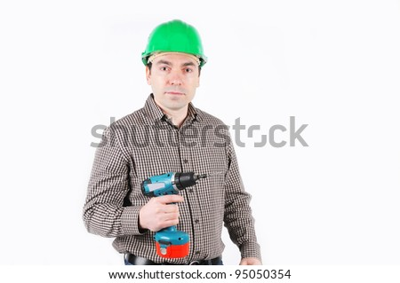 A man with drill in hand - stock photo