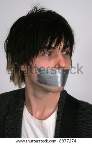 A man with duct tape on his mouth - stock photo