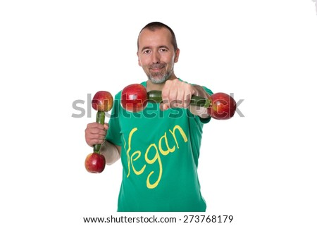 A man with dumbbells standing in front of a white background - stock photo