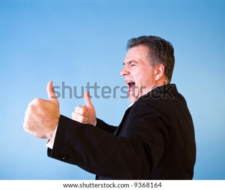 A man with energized, enthusiastic, body language as if invigorated by excellent news. - stock photo