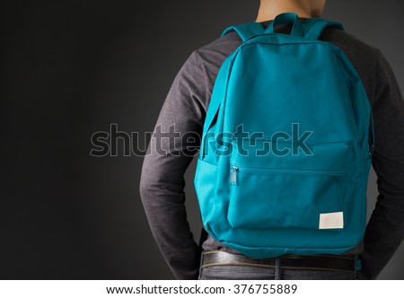 A Man with Green backpack .Education Photo for magazine ,or design work