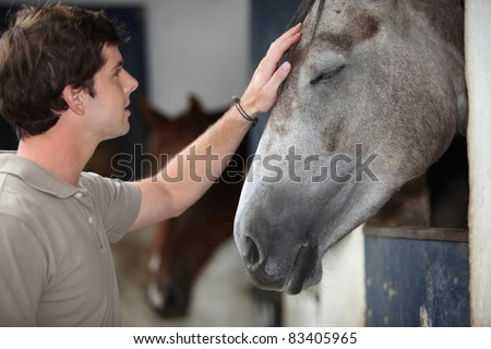 A man with his horse - stock photo