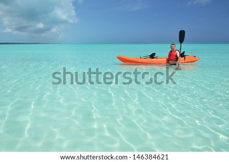 A man with kayak. Exuma, Bahamas - stock photo