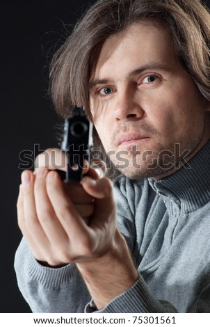 A man with long hair tacking aim. - stock photo