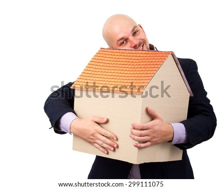 a man with love hugging cardboard house with orange roof