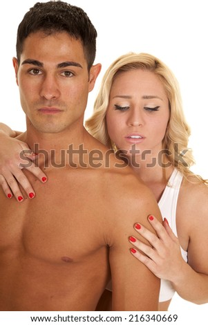 A man with out a shirt on with a woman behind him. - stock photo