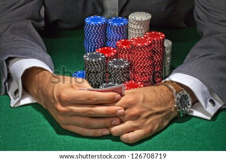 A man with poker chips playing in the casino - stock photo
