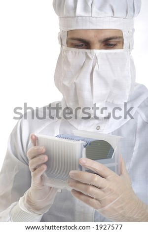 A man with silicon wafers in a box