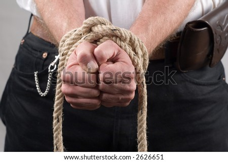 A man with tied hands - stock photo