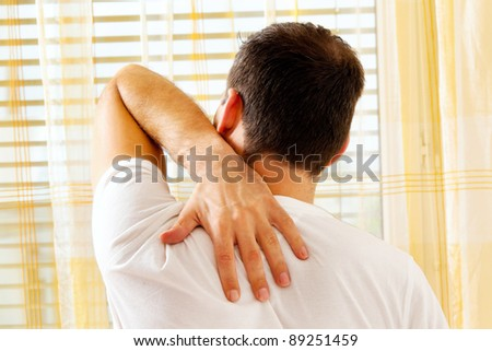 a man woke up the morning after the pain. - stock photo