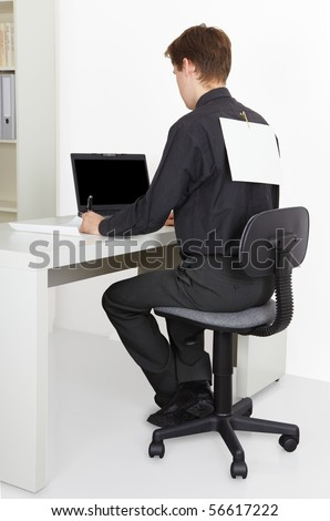 A man working in the office, attach to back poster - stock photo