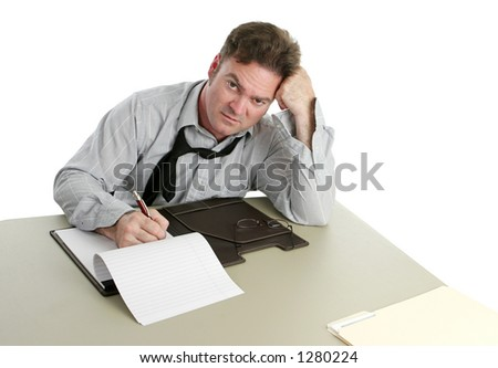 A man working late at the office. - stock photo