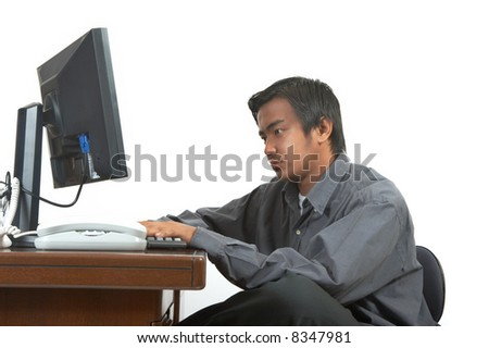 a man working on his desktop computer