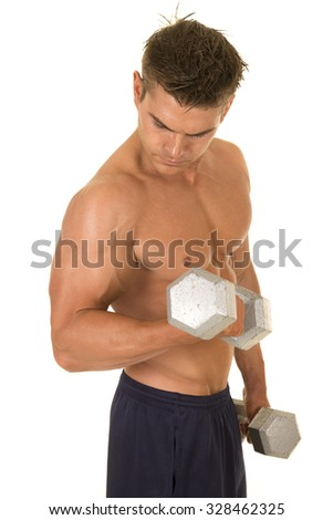 A man working out with weights flexing his arms. - stock photo