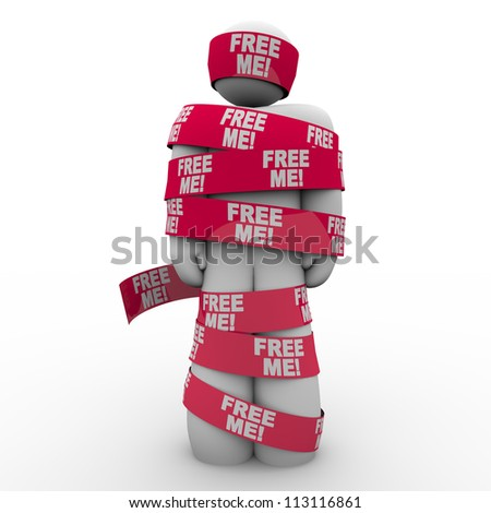 A man wrapped in red tape with the words Free Me to symbolize freedom and escaping from being trapped - stock photo