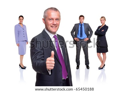 A manager gesturing a thumbs up with a business team behind, isolated on a white background.