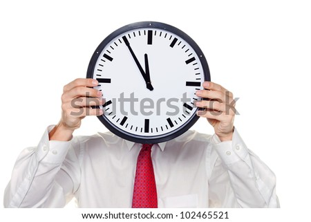 a manager in the head before clock with stress. working in the office. - stock photo