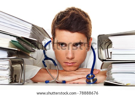 A manager in the stress with stacks of files. Bureaucracy in administration - stock photo
