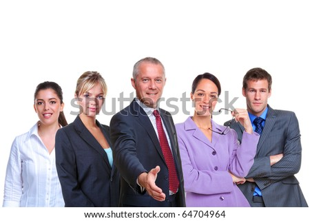 A manager offering to shake your hand with a business team behind, isolated on a white background. - stock photo