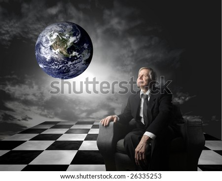 a manager sitting on an armchair and looking planet earth