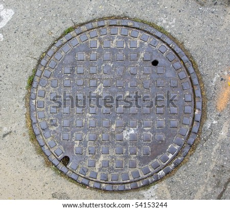 A Manhole Cover in Half Moon Bay, CA