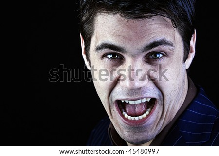 a manic and devil-like businessman shouts at the camera