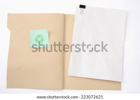 A manila file folder with a clipping path and a recycle sign - stock photo