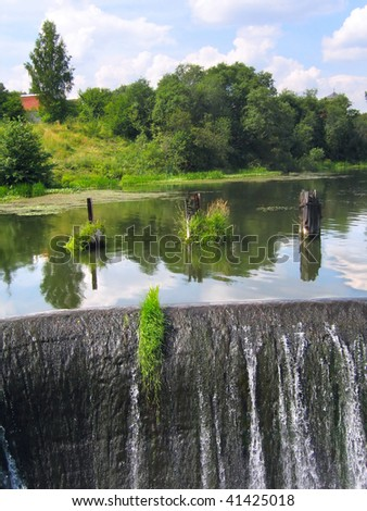 A manmade dam in a small river - stock photo