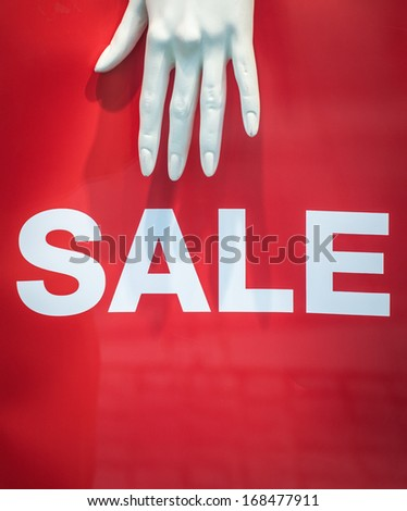 A Mannequin Hand And Sale Sign Retail Store Display - stock photo