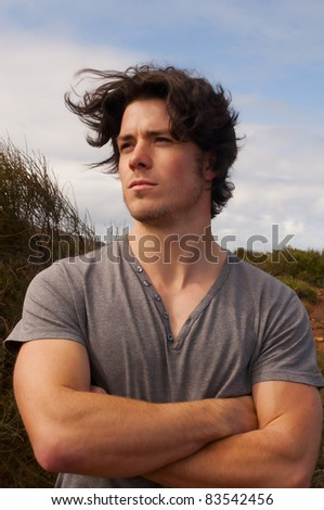 A mans hair blows in the wind - stock photo