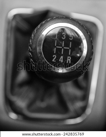 A manual shift of modern car gear shifter  - stock photo