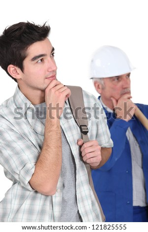 A manual worker and his trainee thinking. - stock photo